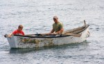 Off the Hook CSF fisherman Orlie Dixon and his son row out to their Cape Islander at Long Island, Nova Scotia. Photo by Becky Boo.